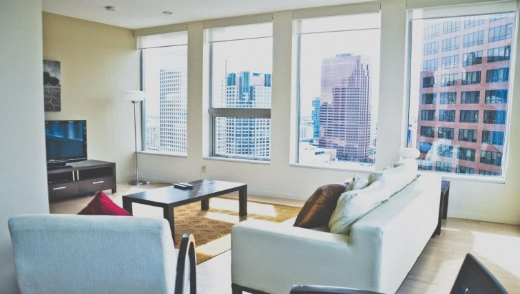 Stylish living area in TenTen Wilshire Apartments