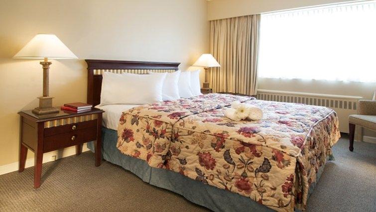 Classy bedroom in Rosellen Suites at Stanley Park