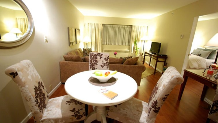 Elegant dining area in Rosellen Suites at Stanley Park