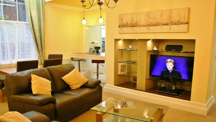 Stylish living area in Holly House Apartments