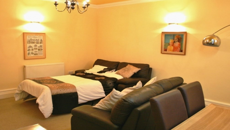 Practical bedroom in Holly House Apartments