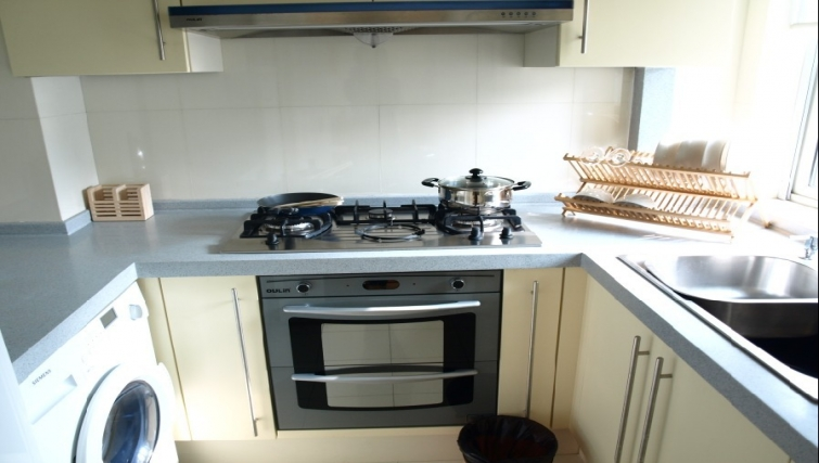 Bright kitchen in Ladoll Serviced Apartment