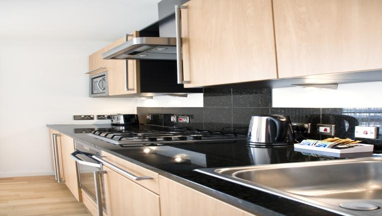 Equipped kitchen at Exchange Apartments