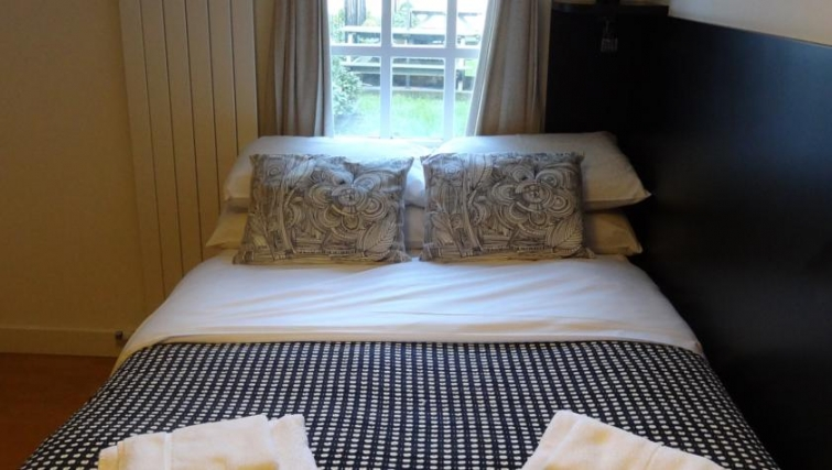 Cosy bedroom at North Gower Apartments