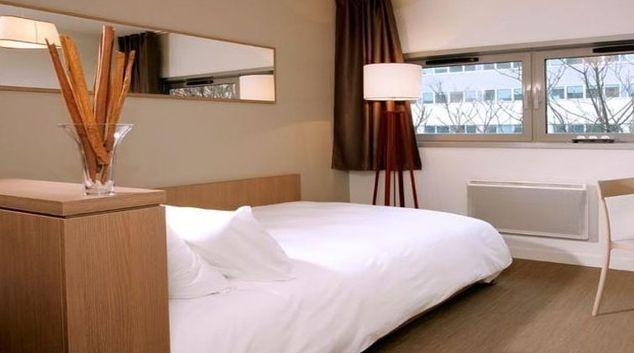 Relaxing bedroom in Appart City Cannes Mandelieu