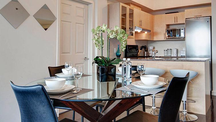 Classy dining area in Le 400 Sherbrooke Ouest Apartments