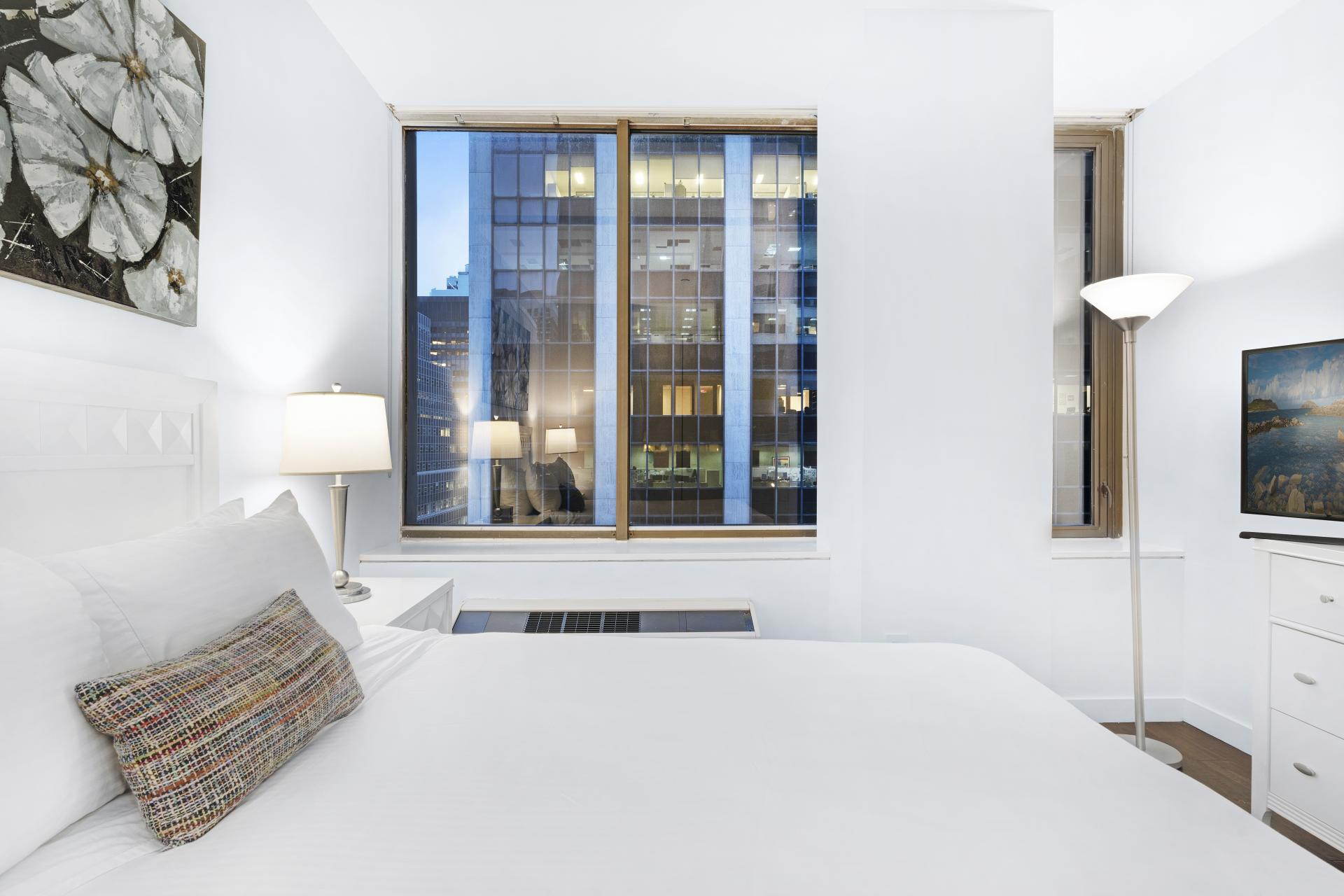 Bed at 95 Wall Apartments, Financial District, Manhattan