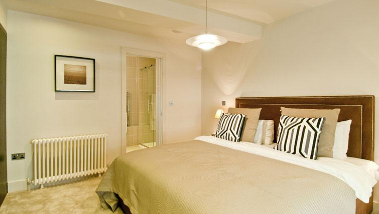 Elegant bedroom in Native Cannon Street Apartments