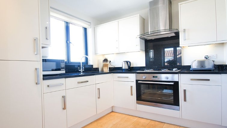 Compact kitchen at Crompton House Apartments