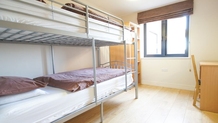 Cosy bedroom at Crompton House Apartments