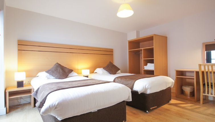 Warm bedroom at Crompton House Apartments