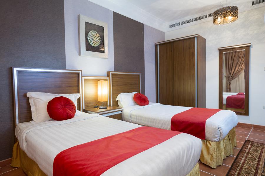 Twin beds at Safari Apartments