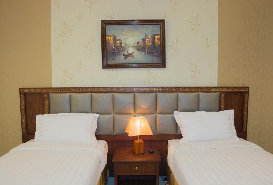 Charming bedroom at Safari Apartments