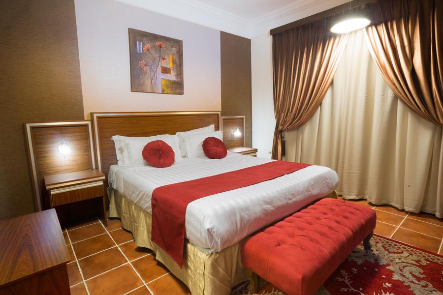 Stylish bedroom at Safari Apartments