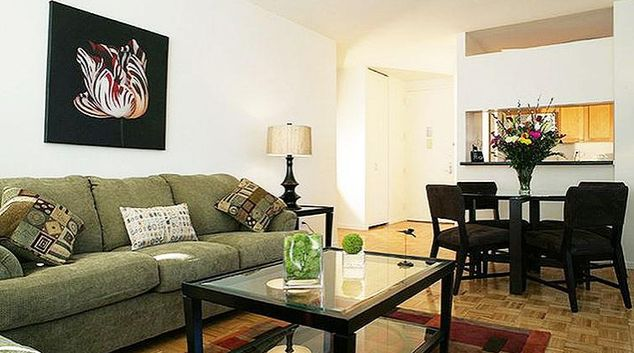 Delightful living area in 305 West 50th Street Longacre Apartments