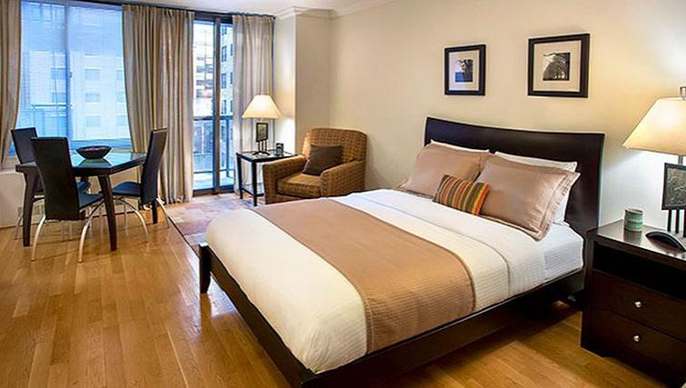 Tasteful bedroom in 235 West 48th Street Apartments