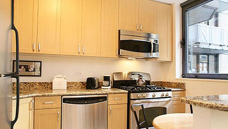 Practical kitchen in 235 West 48th Street Apartments