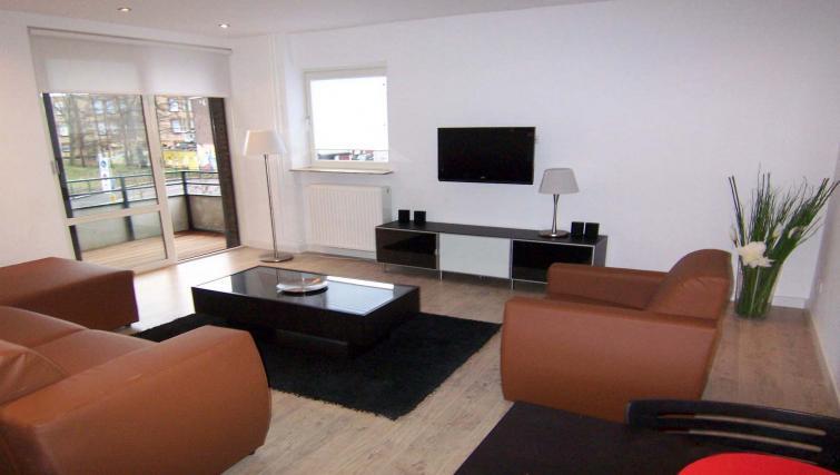Modern living area in Bleekweg Apartments
