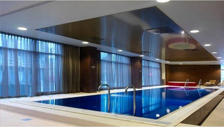 Large indoor swimming pool at Adina Apartment Hotel Copenhagen