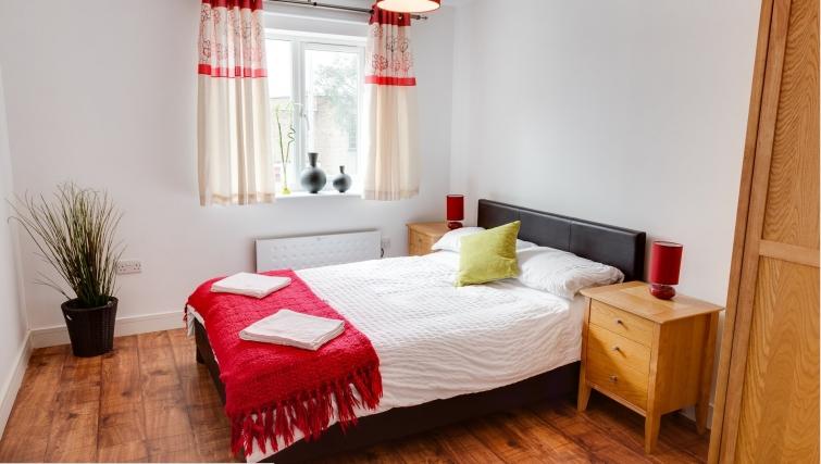 Tasteful bedroom in Meridian Apartment Suites