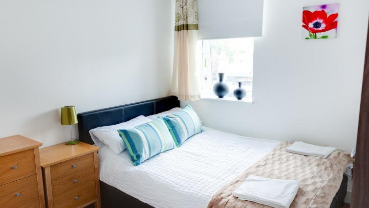 Tranquil bedroom in Meridian Apartment Suites