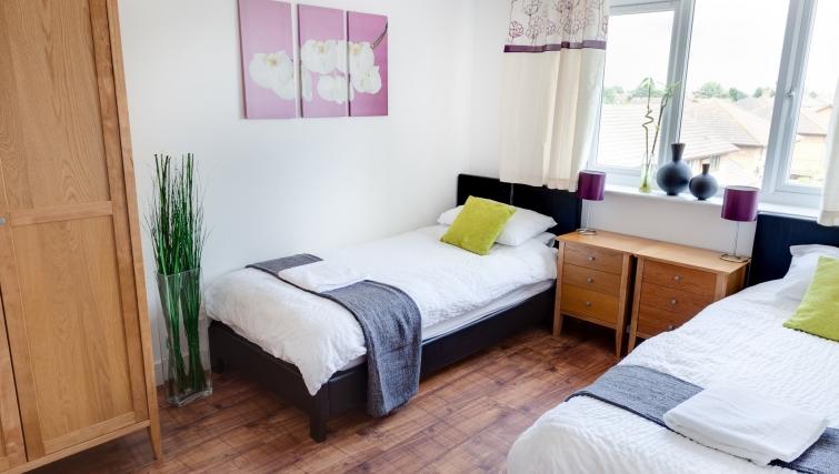 Attractive bedroom in Meridian Apartment Suites