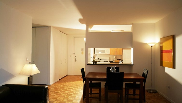 Simplistic dining area in 777 6th Avenue Apartments