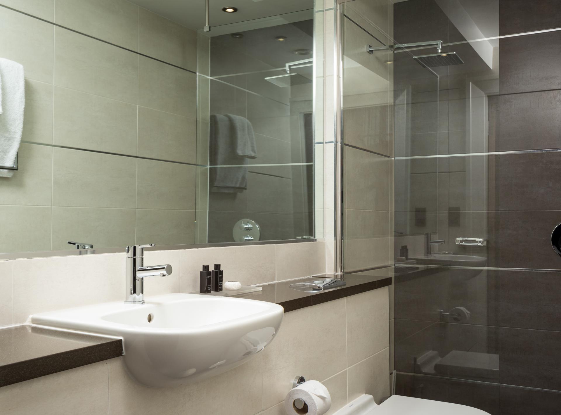 Bathroom at Roomzzz Newcastle City Apartments