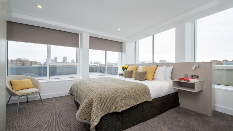 Bright bedroom in The Rosebery Aparthotel