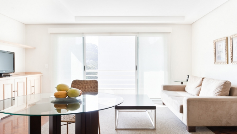 Modern living area in Capote Valente Apartment