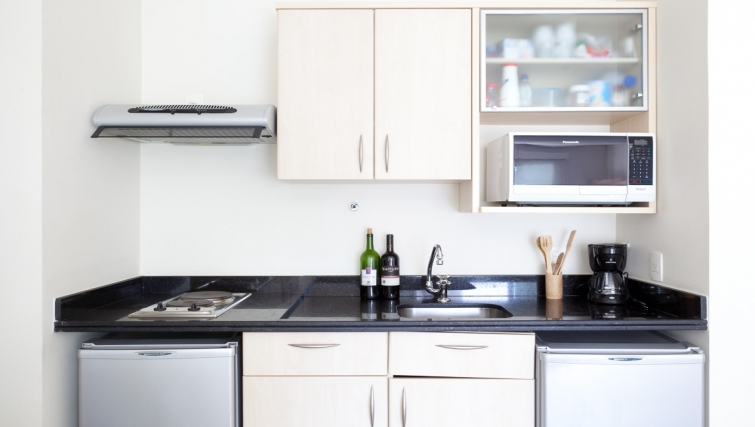 Simplistic kitchen in Capote Valente Apartment