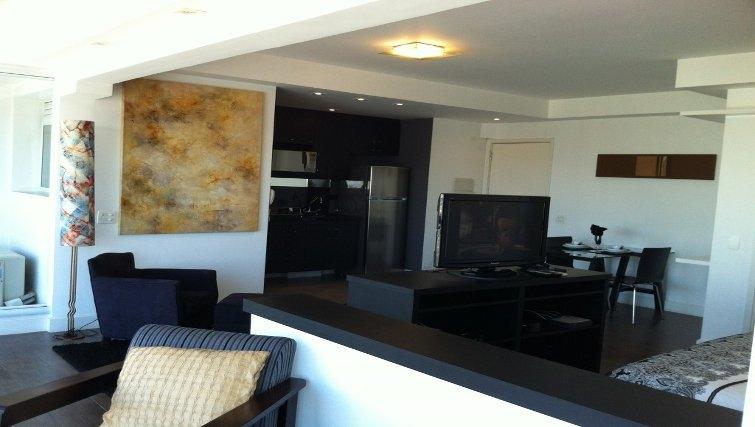 Stylish living area in Mandarim Apartments