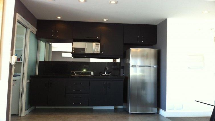 Practical kitchen in Mandarim Apartments