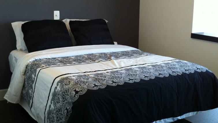 Classy bedroom in Mandarim Apartments