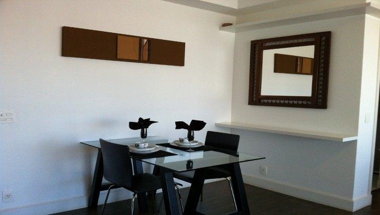 Simplistic dining area in Mandarim Apartments