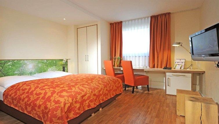 Vibrant bedroom in Best Western Hotel Bremen City