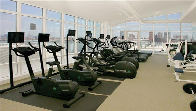 Equipped gym in The Pier Apartments