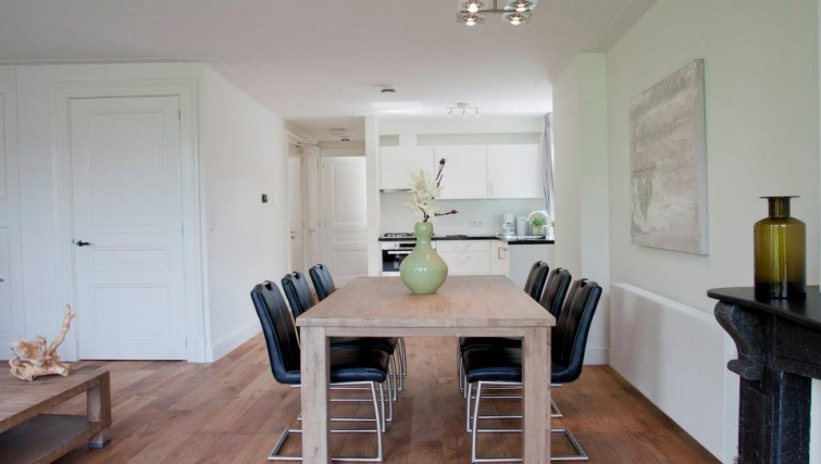 Simplistic dining area in Oudegracht Apartments