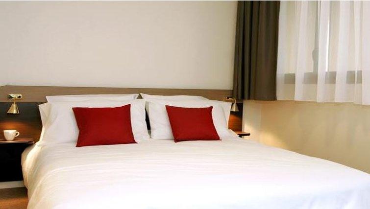 Tranquil bedroom in Appart City Montelimar