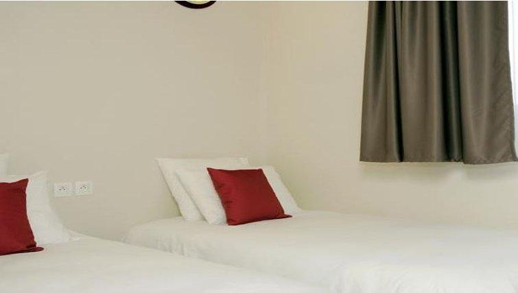 Bright bedroom in Appart City Montelimar