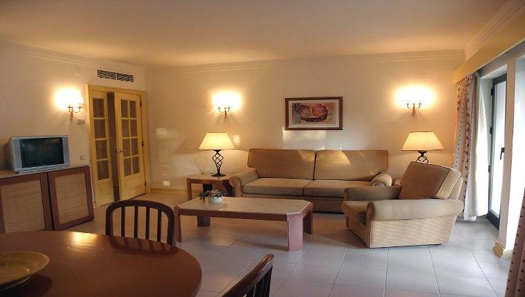Inviting living area in Estoril Apartments