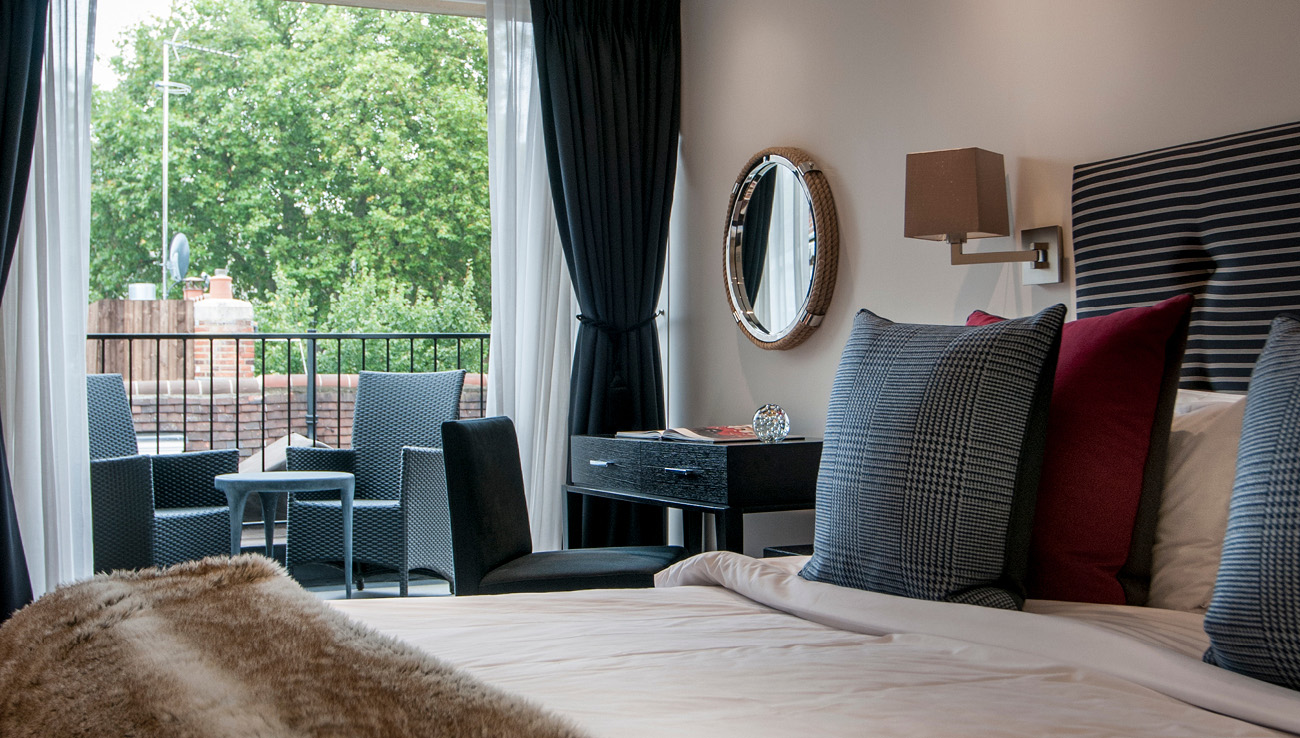 Bed at Native Mayfair Apartments