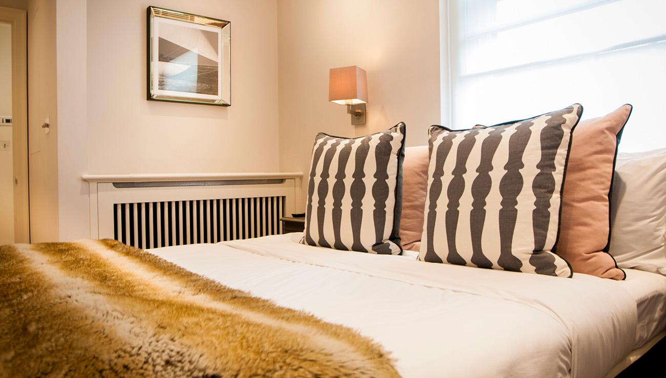 Bedroom at Native Mayfair Apartments