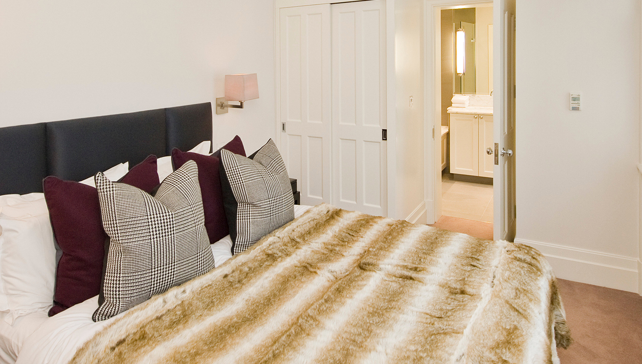 Bedroom and en suite at Native Mayfair Apartments