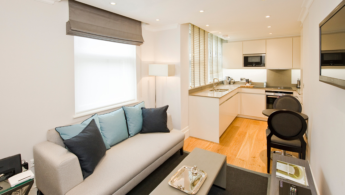 Open-plan living area at Native Mayfair Apartments