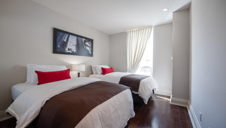 Twin beds at Meridian Apartments