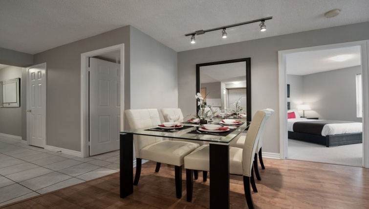 Contemporary dining area in Skymark West Apartments