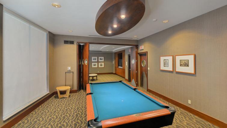 Billiards room at Qwest Apartments