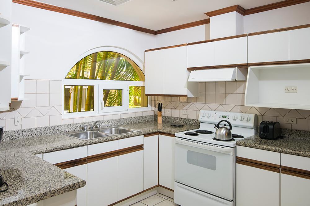 Kitchen facilities at Villas del Rio Aparthotel