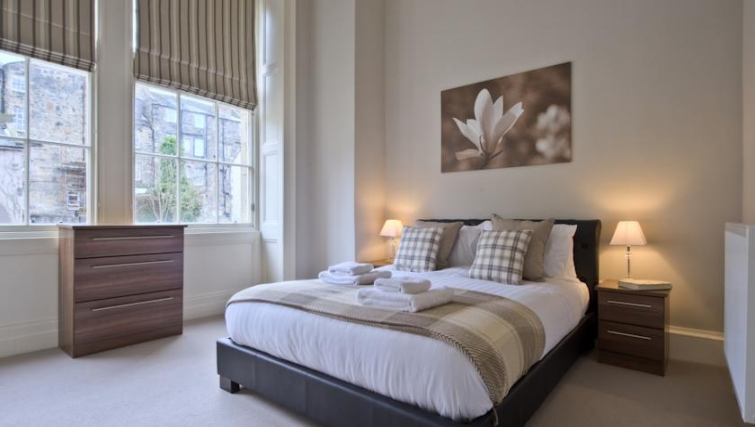 Delightful bedroom in Q Residence Apartments